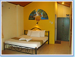 Look into the double bedroom at Family Bungalow
